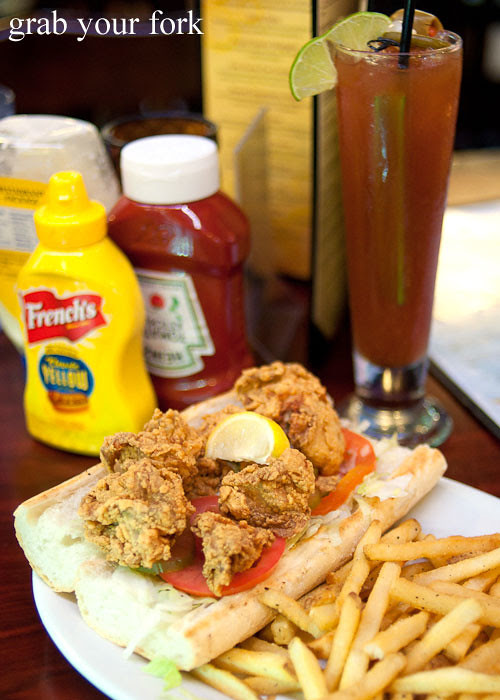 oyster po' boy at pier 424 seafood market on bourbon street in new orleans louisiana