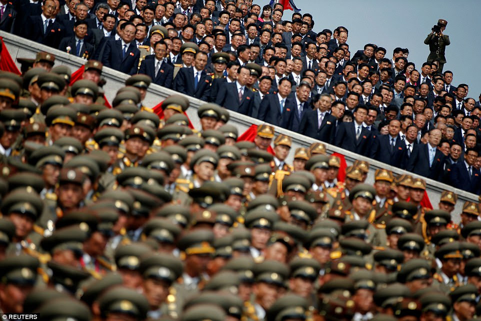 Soldiers march through Pyongyang as officials look on at the celebration event, a national holiday in North Korea