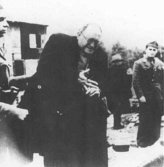Ustasa (Croatian fascist) camp guards order a Jewish man to remove his ring before being shot. Jasenovac concentration camp, Yugoslavia, between 1941 and 1945.