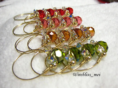 rows of wire wrapped sparkly crystal rings