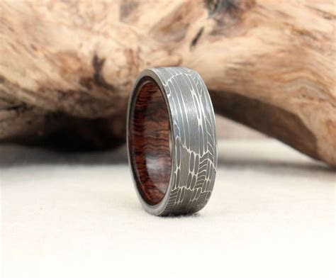 Hand Wrought Damascus Steel & Wood Rings   DudeIWantThat.com