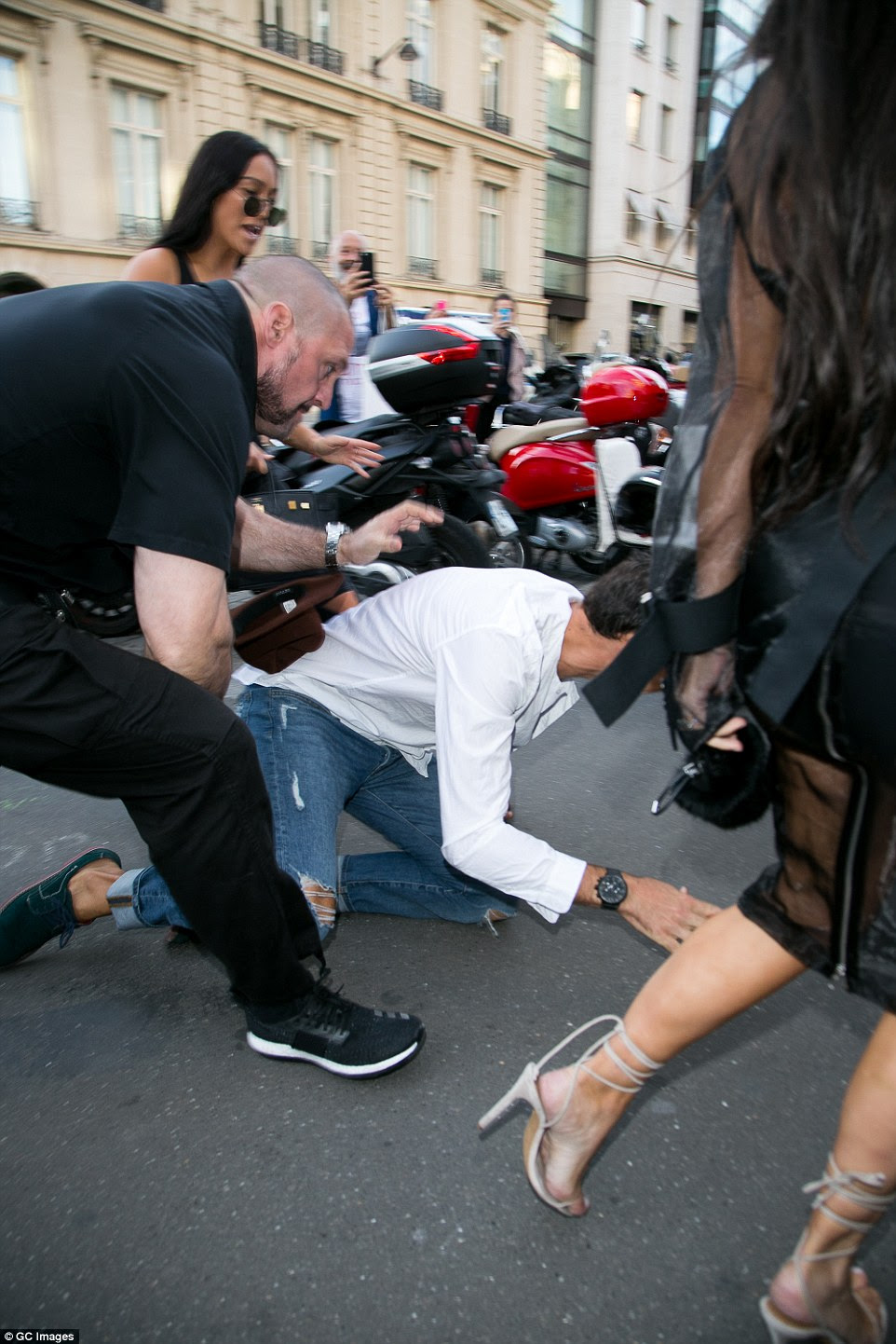 Take down: Kim declared 'Pascal's a G! He's the best bodyguard in town' after he saved her from being grabbed by prankster Vitalii Sediuk in Paris