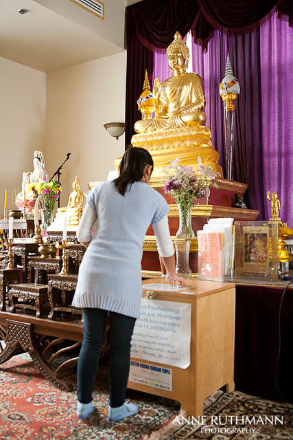 Making a donation to Buddhist temple