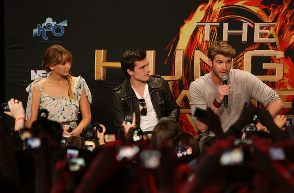 Actors Jennifer Lawrence, Josh Hutcherson and Liam Hemsworth attend The Hunger Games U.S. Mall Tour Kick-Off at Westfield Century City on March 3, 2012 in Los Angeles, California.