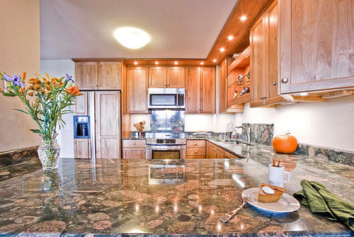 Matching countertops and flooring with these oak cabinets