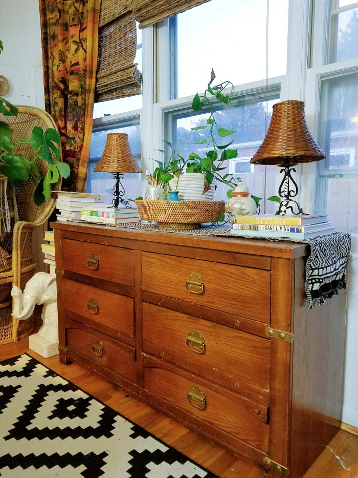 Thrifted dresser with interesting hardware styled as a dining room buffet credenza