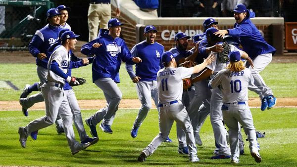 The Los Angeles Dodgers celebrate after defeating the Chicago Cubs, 11-1, in Game 5 of the National League Championship Series (NLCS)...on October 19, 2017.