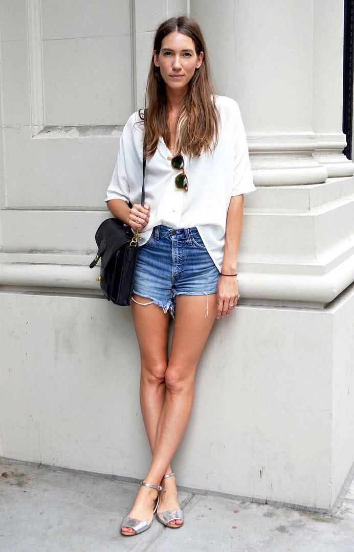 Le Fashion Blog - New York Street Style - Summer Casual - Slouchy White Shirt, Cut Offs and Silver Sandals - Via WGSN photo Le-Fashion-Blog-New-York-Street-Style-Summer-Casual-Cut-Offs-Silver-Sandals-Via-WGSN.jpg