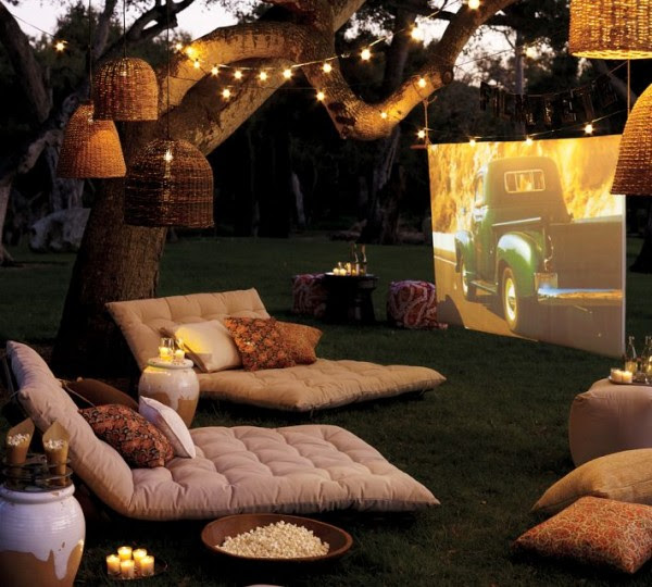 outdoor cinema with soft furishings and tree lighting