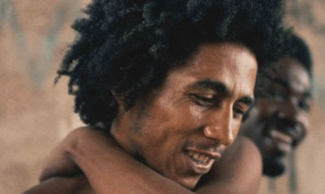 Researchers say that listening to artists such as Bob Marley (pictured) can improve our mood. they also found Prince and the Beachboys can have a similar effect