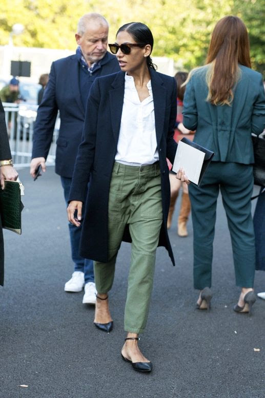 Le Fashion Blog Classic Street Style Round Sunglasses Long Coat Green Utility Pants Gianvito Rossi Flats Via Vogue Australia