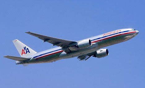 An American Airlines flight is pictured takin off into a clear blue sky