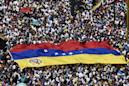 Venezuelans rally for and against embattled Maduro on revolution anniversary