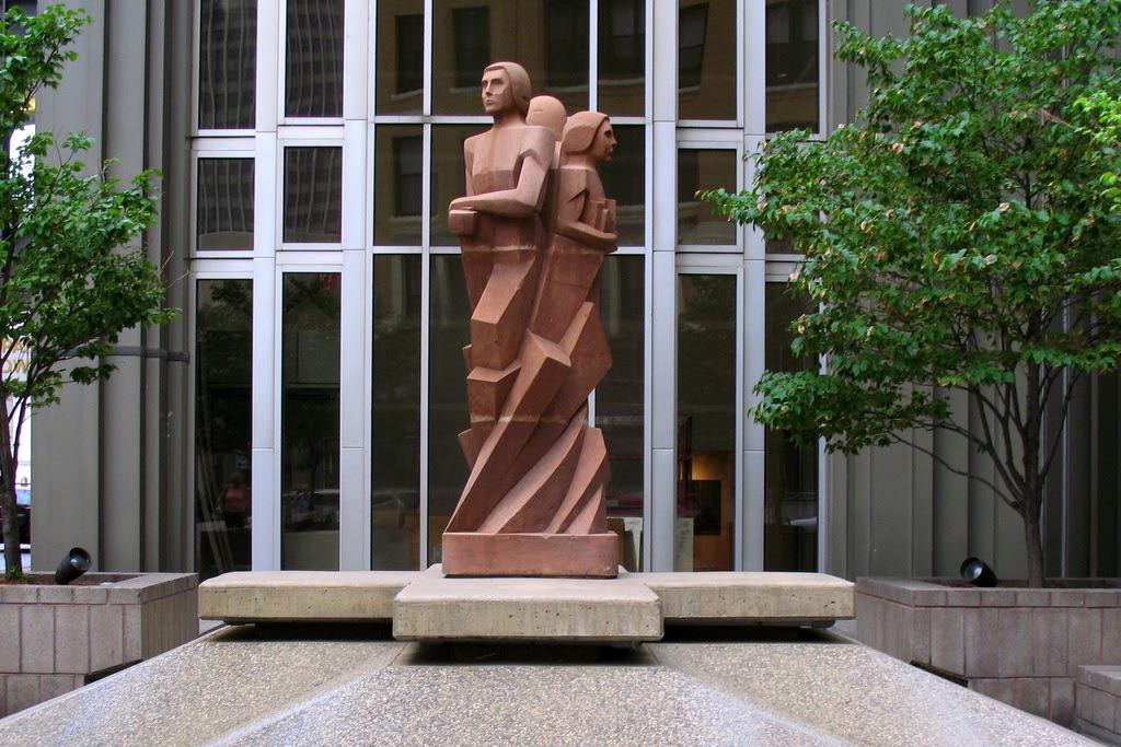 This sculpture stands at in front of the Amhoist Tower in downtown St Paul on 4th and St. Peter. It was dedicated on October 12, 1983, Estanislao Contreras was the sculptor, Juan M. Munguia was the designer.
