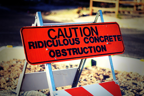 CAUTION RIDICULOUS CONCRETE OBSTRUCTION