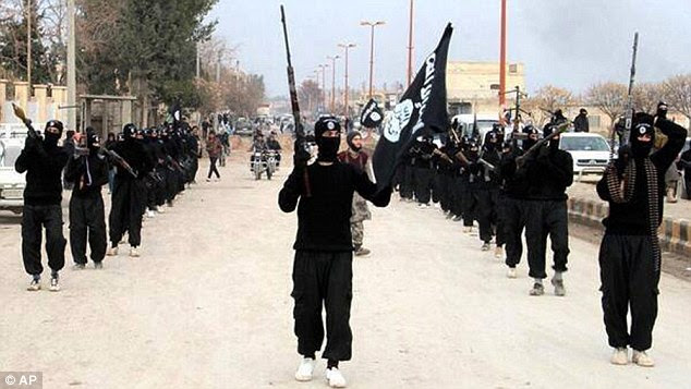 Huge support: Fighters from the Islamic State march through their stronghold of Raqqa in Syria