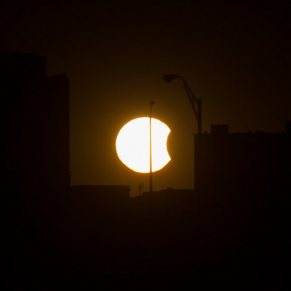 A partial solar eclipse is visable just before sunset Thursday, Oct. 23, 2014, in Arlington, VA. Photo Credit: (NASA/Bill Ingalls)