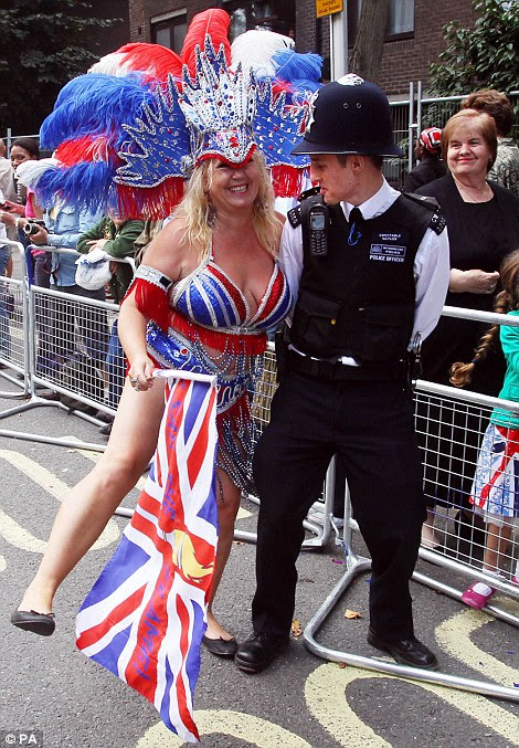 One of the participants dances with a police officer