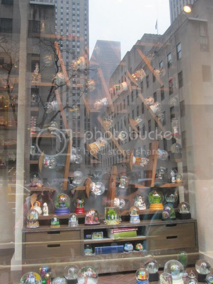 """This display (again I """"think"""" it was at Saks) was really cool.  different sections would tip and turn to make the snow globes work."""