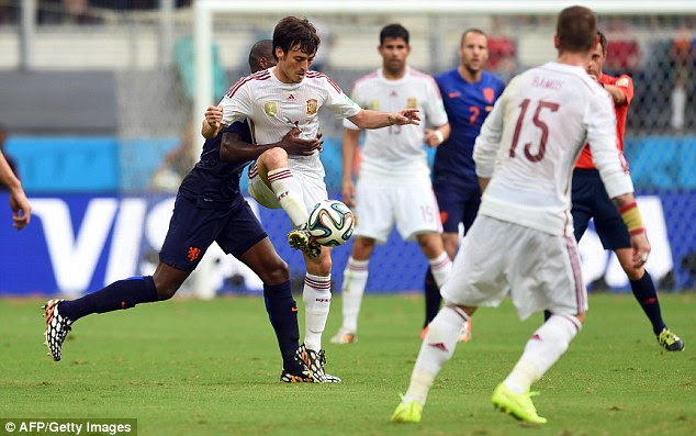 Stop right there: Holland defender Bruno Martins Indi (left) grabs hold of Spain midfielder David Silva