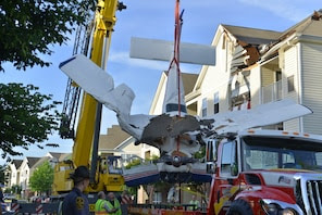 HERNDON, VA - MAY 31: A Cessna 177 airplane is lifted from the roof of an apartment building after running out of fuel while flying from Philadelphia on Friday, May 31, 2013, in Herndon, VA. (Photo by Jahi Chikwendiu/The Washington Post)