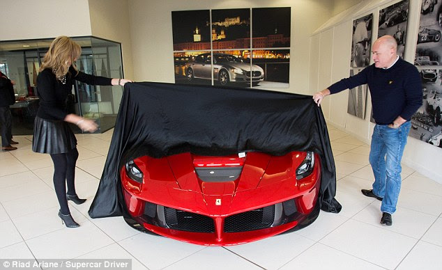 Big reveal: Mr and Mrs Bailey take the wraps of their new La Ferrari - one of only 499 that will be produced