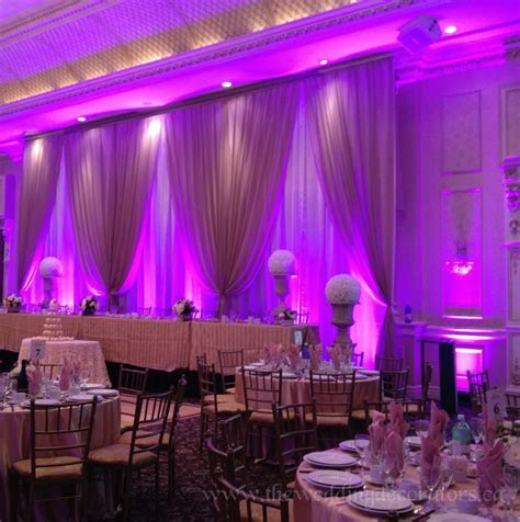 Wedding backdrop with elegant LED lighting.   Ideas for L