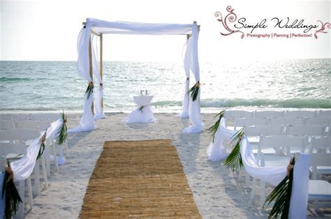 Beautiful bamboo aisle runner and palm frond aisle decor