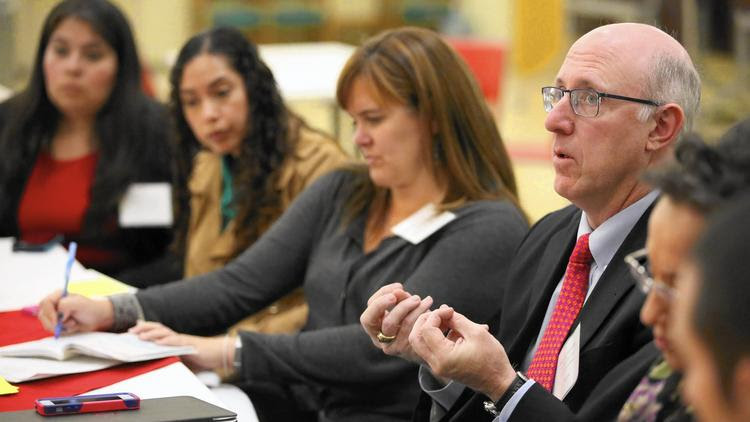 Gregory McGinity speaks during a forum on L.A. public schools