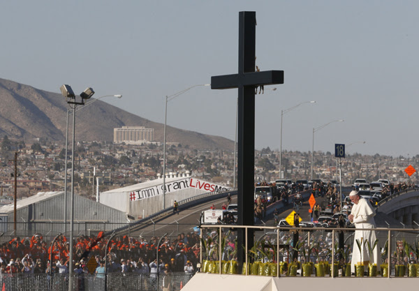 Pope Francis prays at a cross on the border with El Paso, Texas, before celebrating Mass at the fairgrounds in Ciudad Juarez, Mexico, Feb. 17. Photo © Catholic News Service/Paul Haring