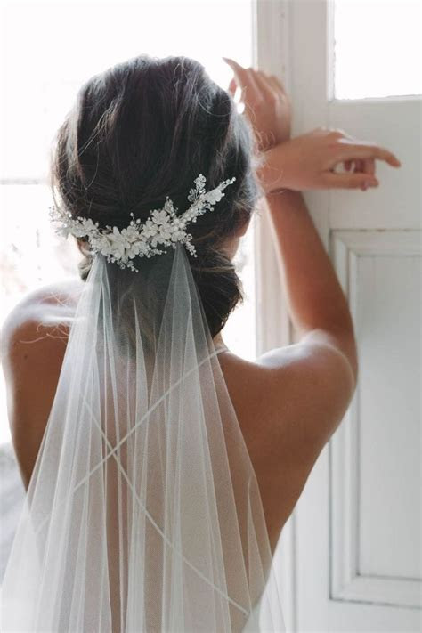 Best 25  Wedding hairstyles veil ideas on Pinterest