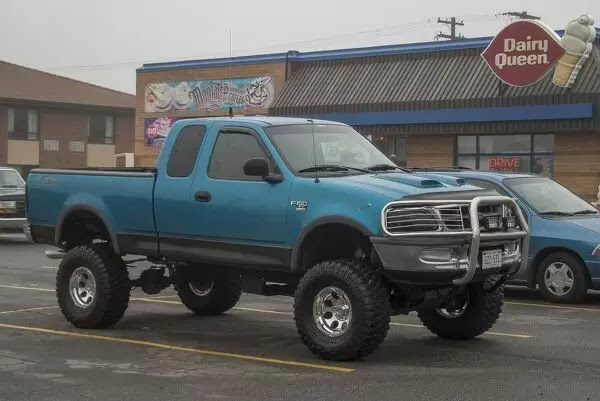 Jigsaw Puzzle 400 Pieces Of A Customized Ford F150 With Big Wheels And Tyres Outside A Dairy Queen Fast Food