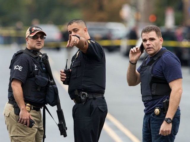 9: Law enforcement officials gather at the site where Ahmad Khan Rahami, who was wanted in connection to Saturday night's bombing in Manhattan, was arrested after a shootout with police, September 19, 2016 in Linden, New Jersey. On Monday morning, law enforcement released a photograph of 28-year-old Ahmad Khan Rahami, who they are seeking in connection to the attack. (Photo by
