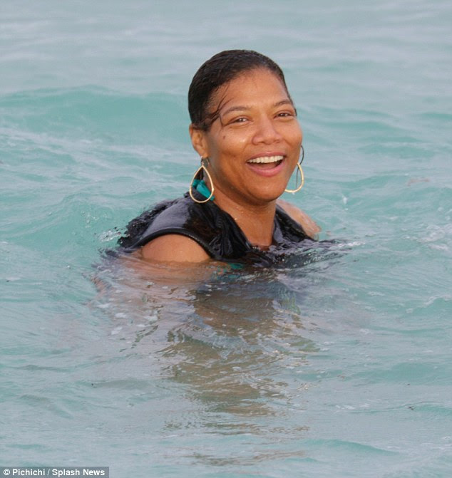 Make-up free: Latifah didn't bother with any make-up, removing her sunglasses at one point to show off her natural beauty