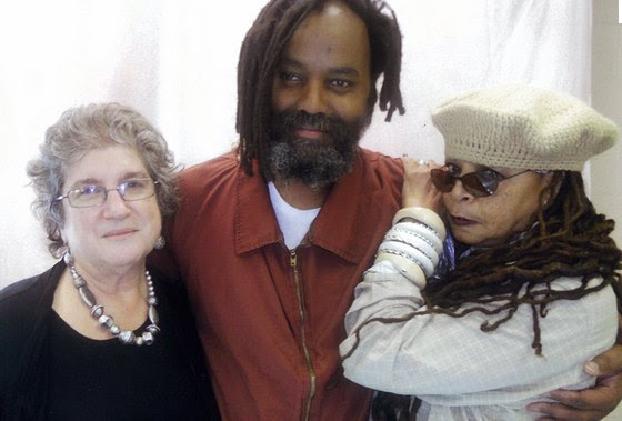 Mumia, off death row but fighting to escape life in prison, with attorney Rachel Wolkenstein and his wife Wadiya Jamal