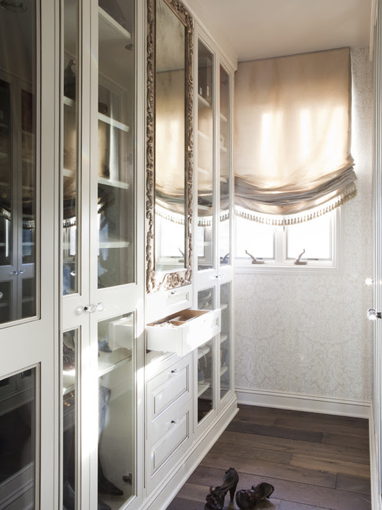 Beautiful closet design with glass fronted closet doors to shelves white feminine