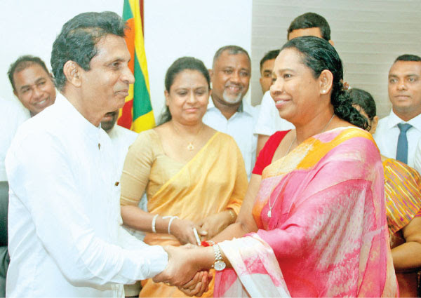 Women and Child Affairs State Minister Vijitha Berugoda assumed duties at his Ministry yesterday. Minister Pavithara Wanniarachchi was also present. Picture by Roshan Pitipana.