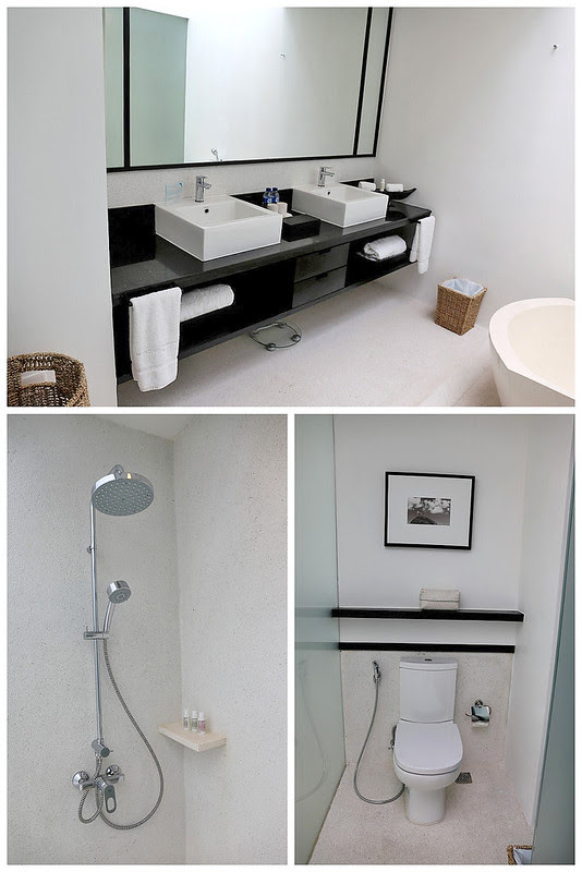 The bathroom has separate shower and toilet facilities, as well as double washbasins
