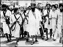 Jarnail Singh Bhindranwale, centre, with supporters