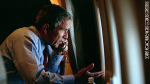 As Air Force One approaches Washington, Bush talks with Vice President Cheney while looking at the smoldering Pentagon.