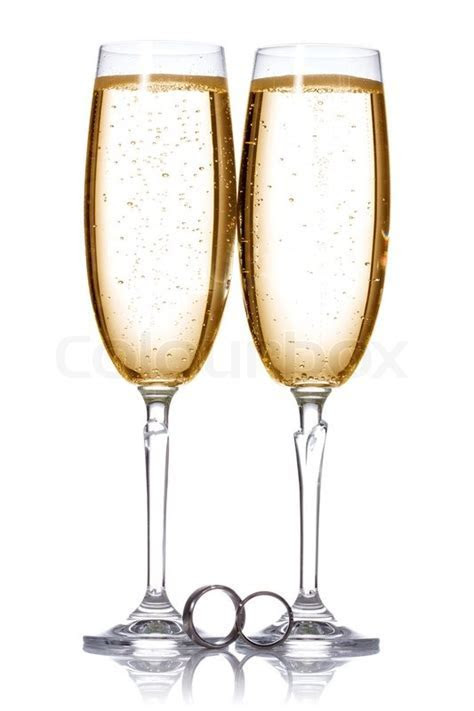 Two glasses of champagne with wedding rings.   Stock Photo