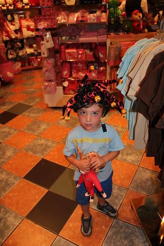 Olsen trying on hats