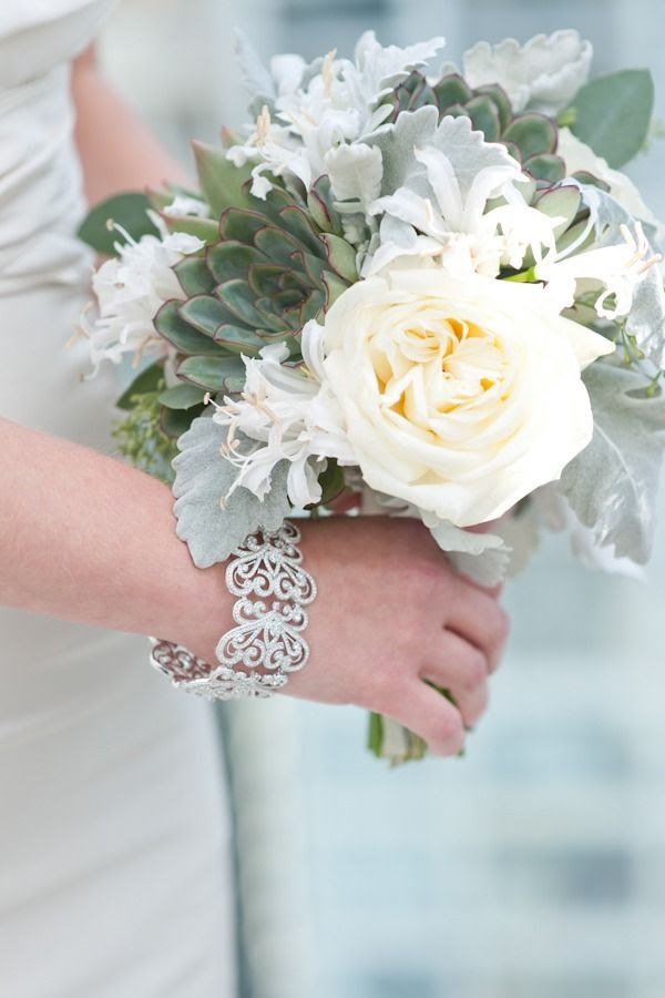 Garden rose, succulent, dusty miller, nerine lily bridal bouquet