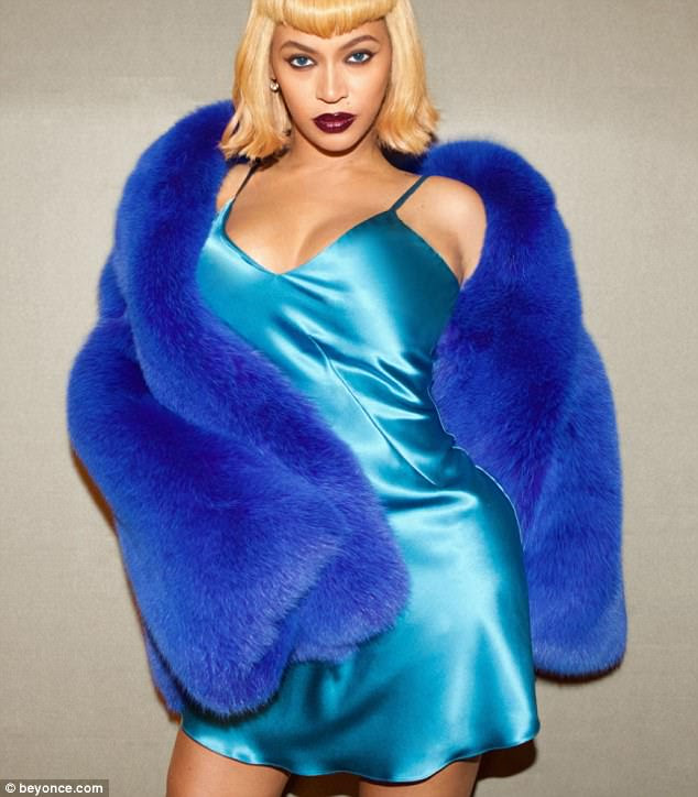 Bedroom eyes:Things then got a bit sensual, as Beyonce rocked a turquoise nightie with cobalt blue stole that was a takeoff of Kim's Today's Blackwoman Magazine cover shot in 2000