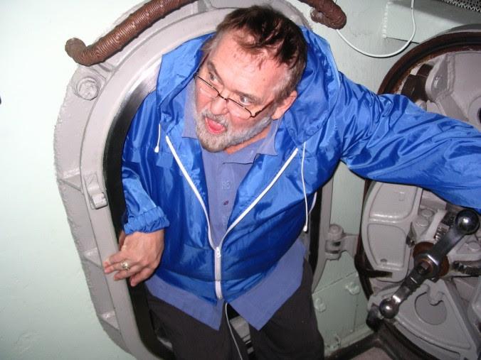 Jim goes through a porthole on a submarine.