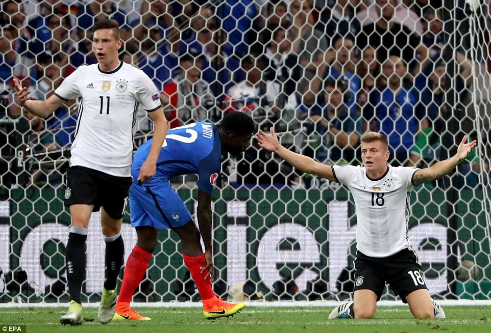 Kroos appeals for penalty after taking a tumble in the France penalty area but referee Rizzoli waved away the claims