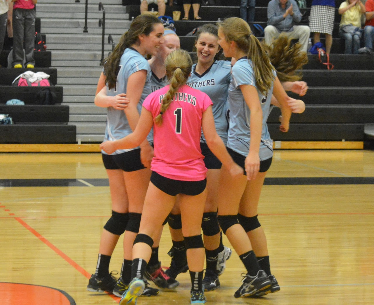 Franklin players celebrate the final point of the fifth set in a 3-2 victory over previously unbeaten Taunton on Monday. (Josh Perry/HockomockSports.com)