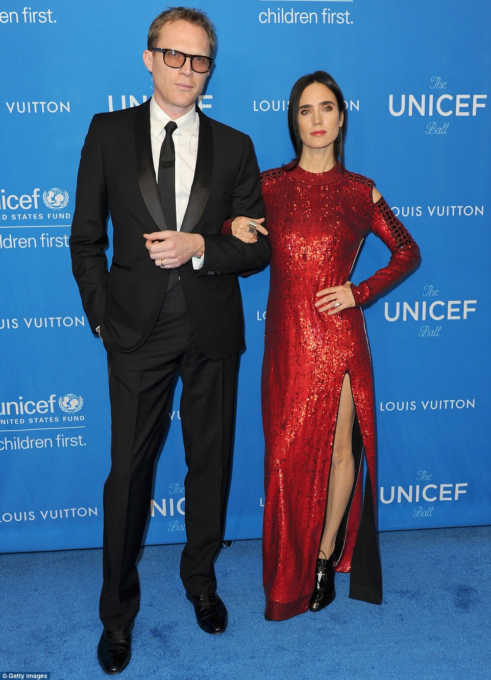 Cute couple: Jennifer Connelly, dressed in glittering red, was joined by husband Paul Bettany