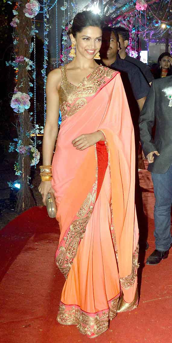 Deepika Padukone in pink saree at a wedding reception ...