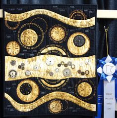 It's About Time, Kim Frisk, Green Bay, WI  This small quilt won first place in the Art Quilt division. It's totally packed with watch parts, gears, clock faces, and phrases about time. My photos don't do the quilt justice. It's really amazing.